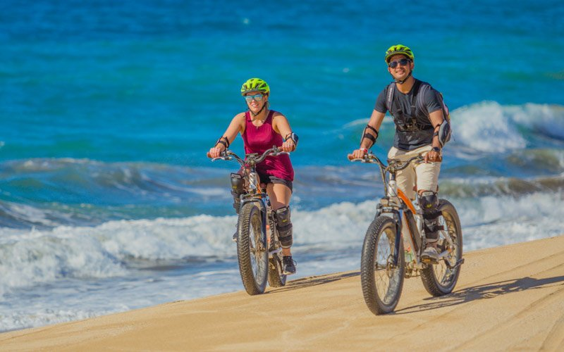 Cabo vacationers on electric mountain bike cabo adventures tour|