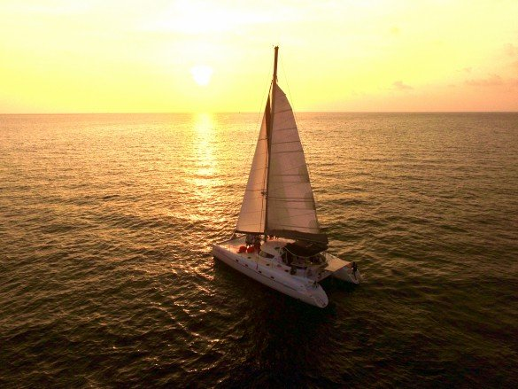 Luxury sunset sailing in Cancun at Night with Cancun Adventures