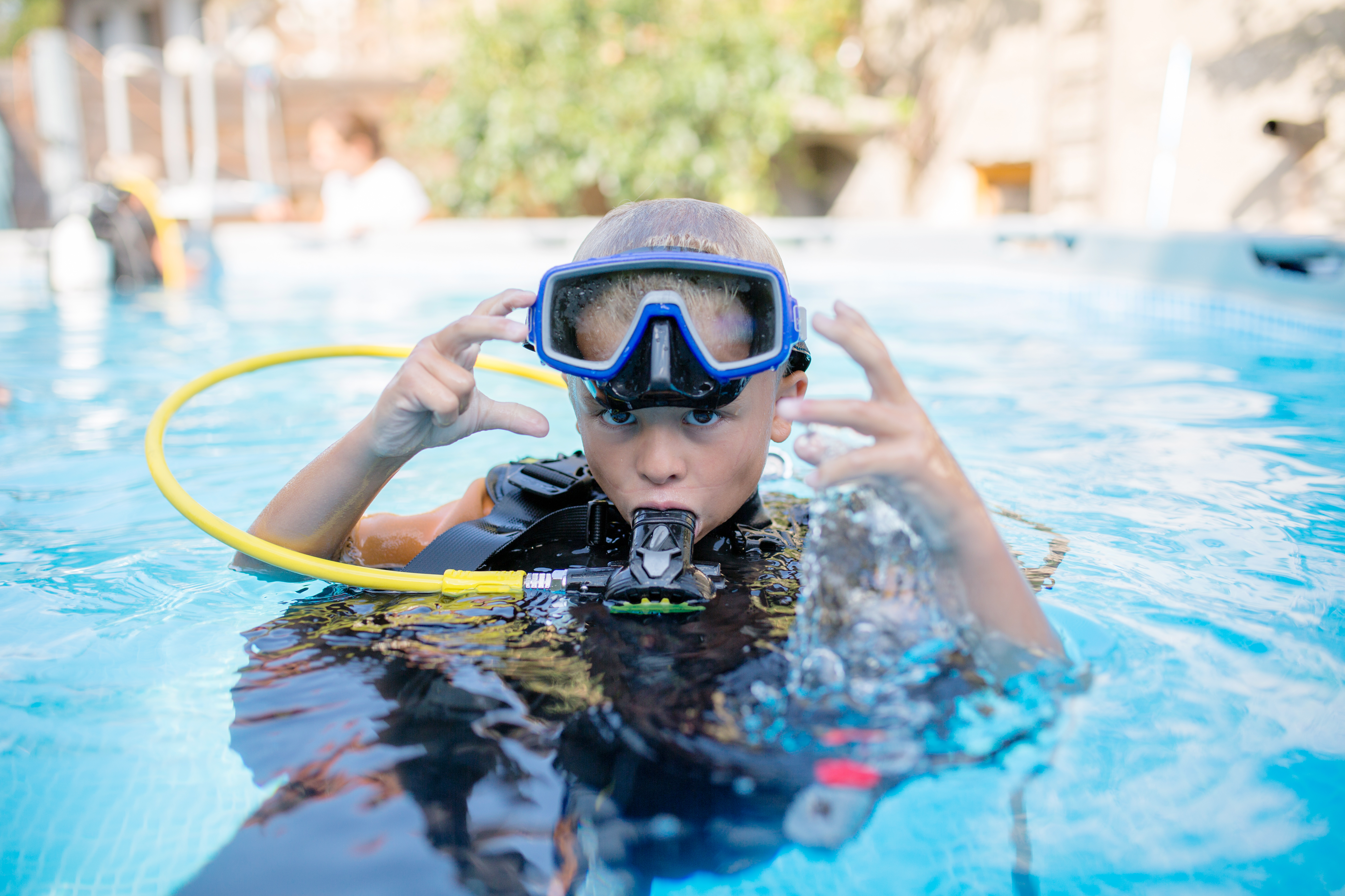 young boy scuba diving