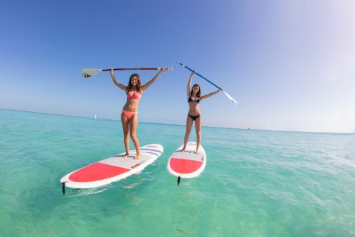 two women on paddle boards in cancun