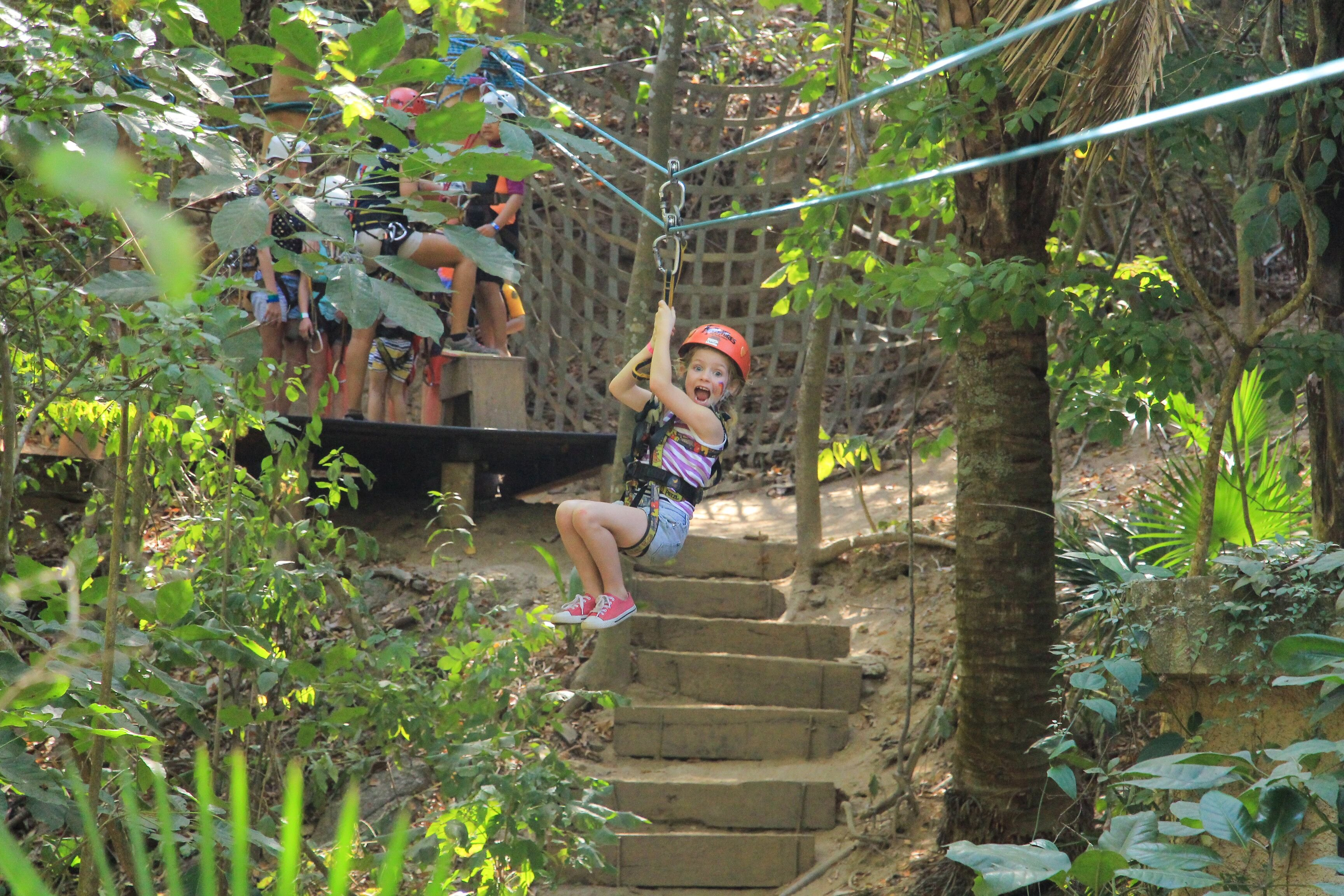kid zip lining at kids adventure park in las caletas