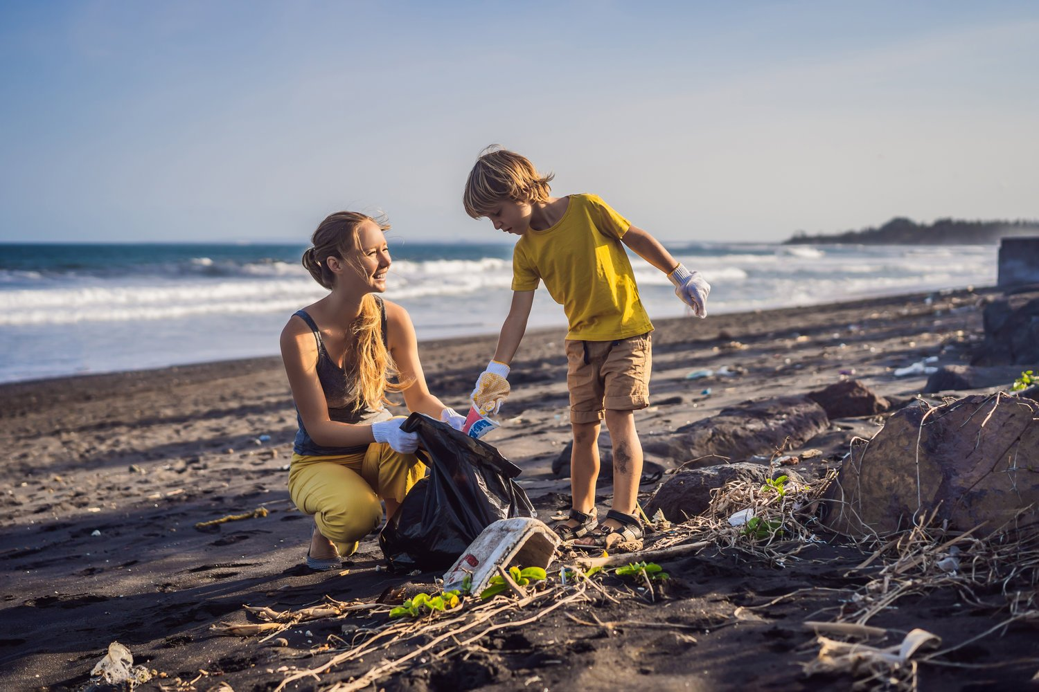 Mother Son Cleaning Beach