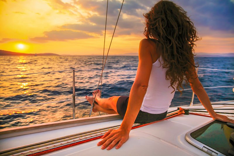 woman watching cabo sunset on luxury sailing tour