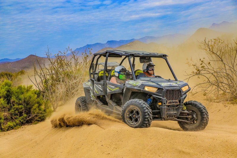 cabo vacationers on atv tour in cabo desert