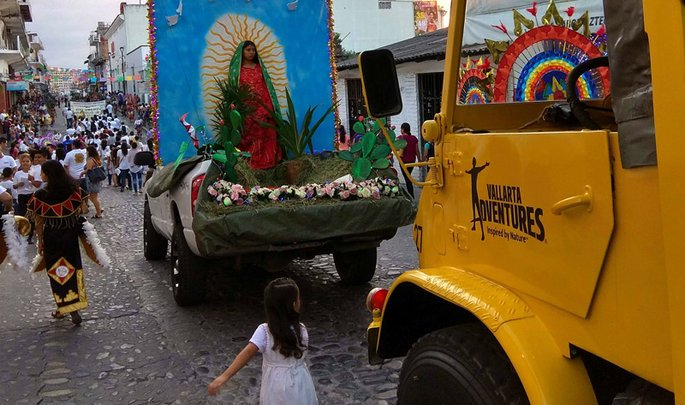Virgen de Guadalupe statute on a truck