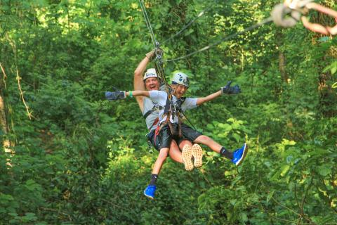 father and son zip lining together in puerto vallarta